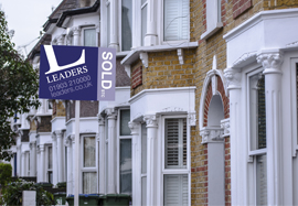 Leaders sold board in a street of houses