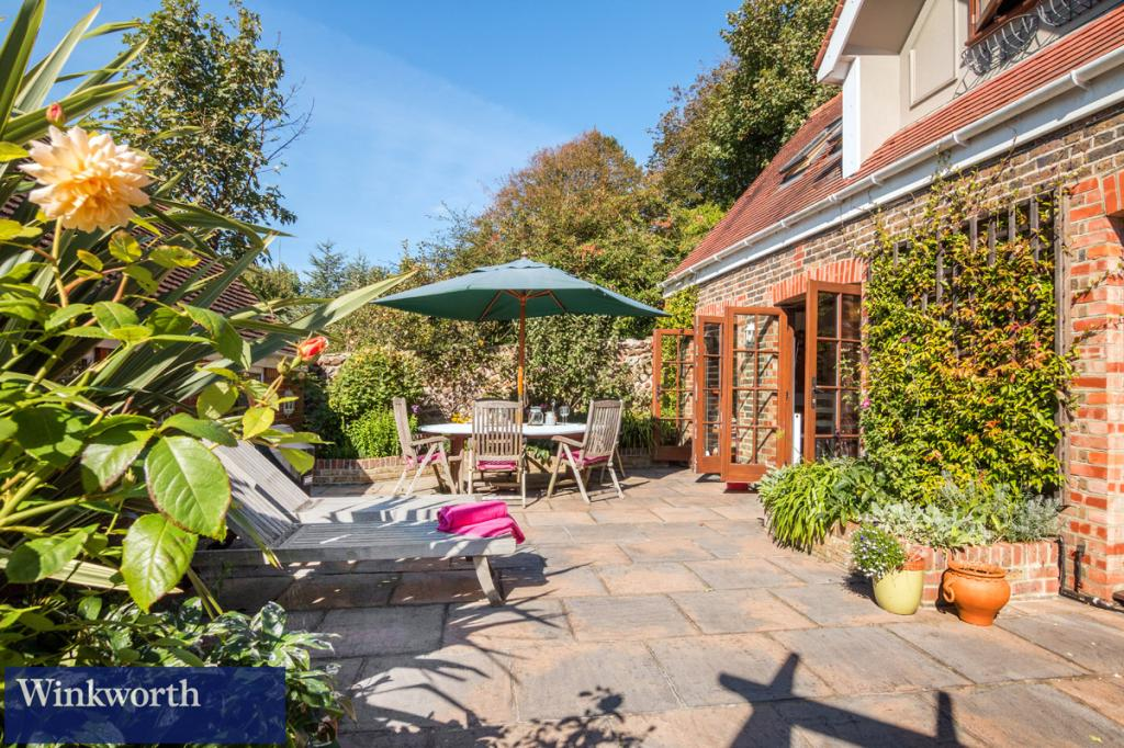 A beautifully renovated former coach house set back from Preston Park